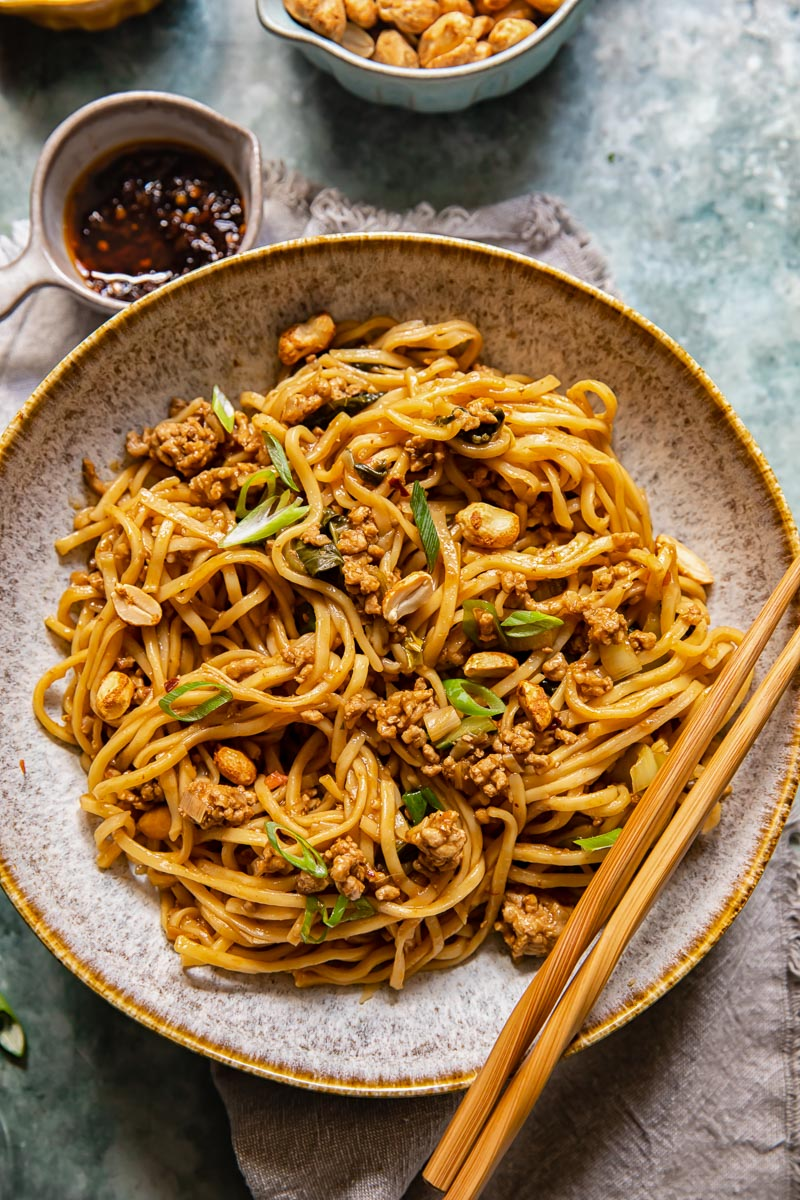 Chinese noodles in a bowl with chopsticks resting on the bowl