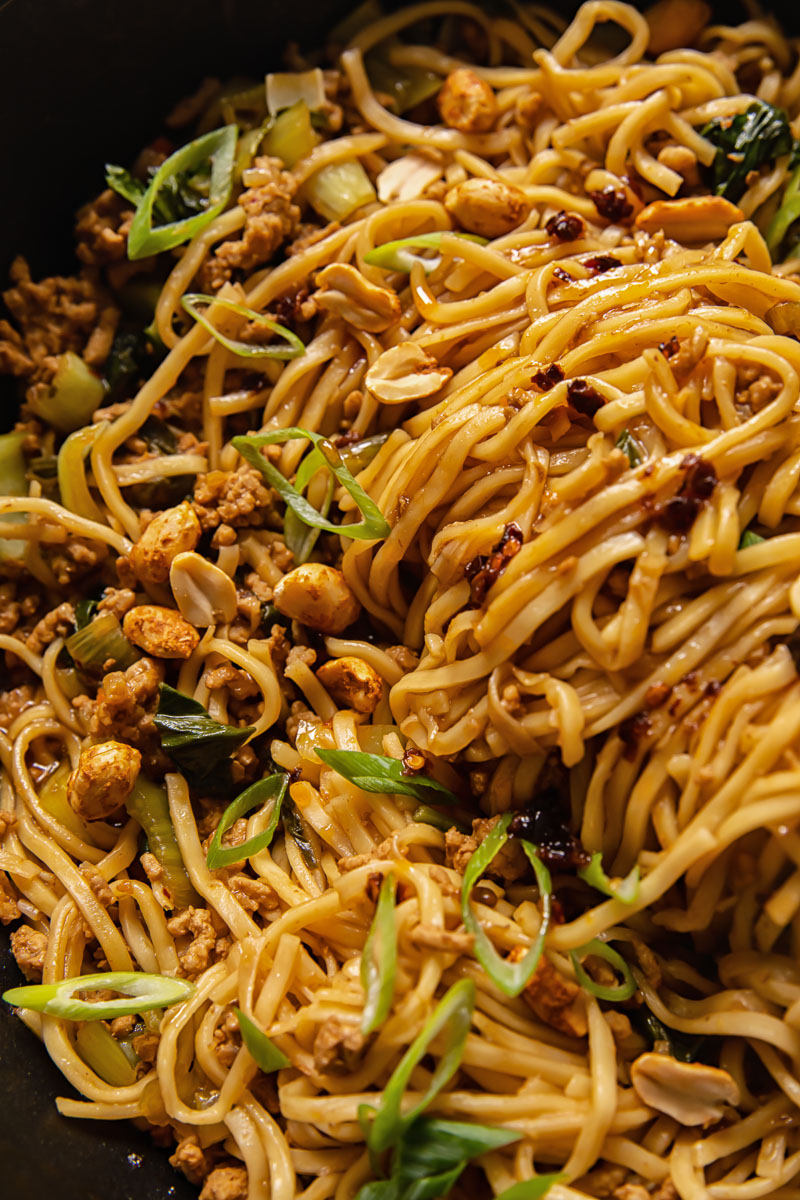 close up of a Chinese noodle dish in a wok