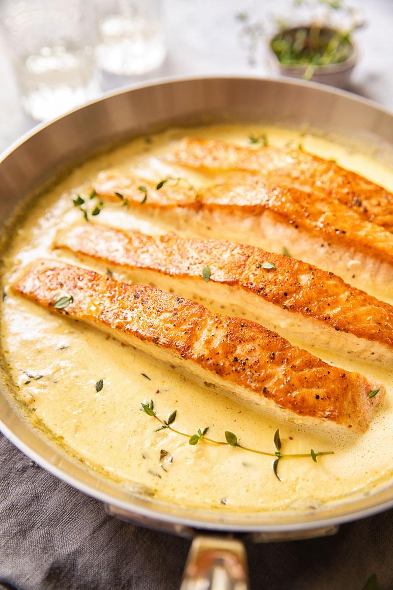 salmon in cream sauce in a pan