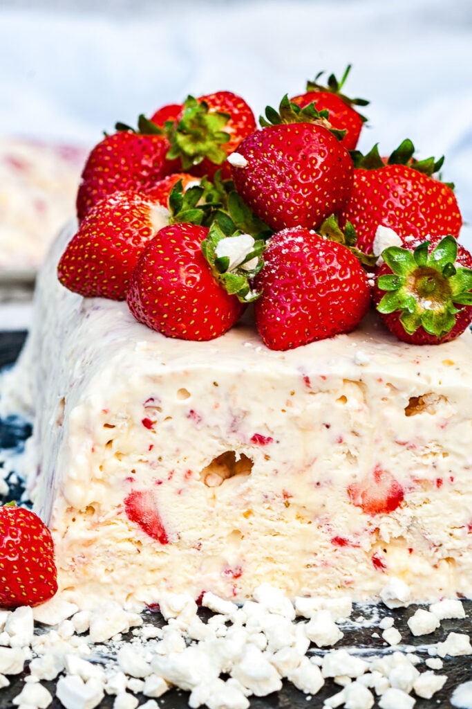 Side view of semifreddo with strawberries on top and inside