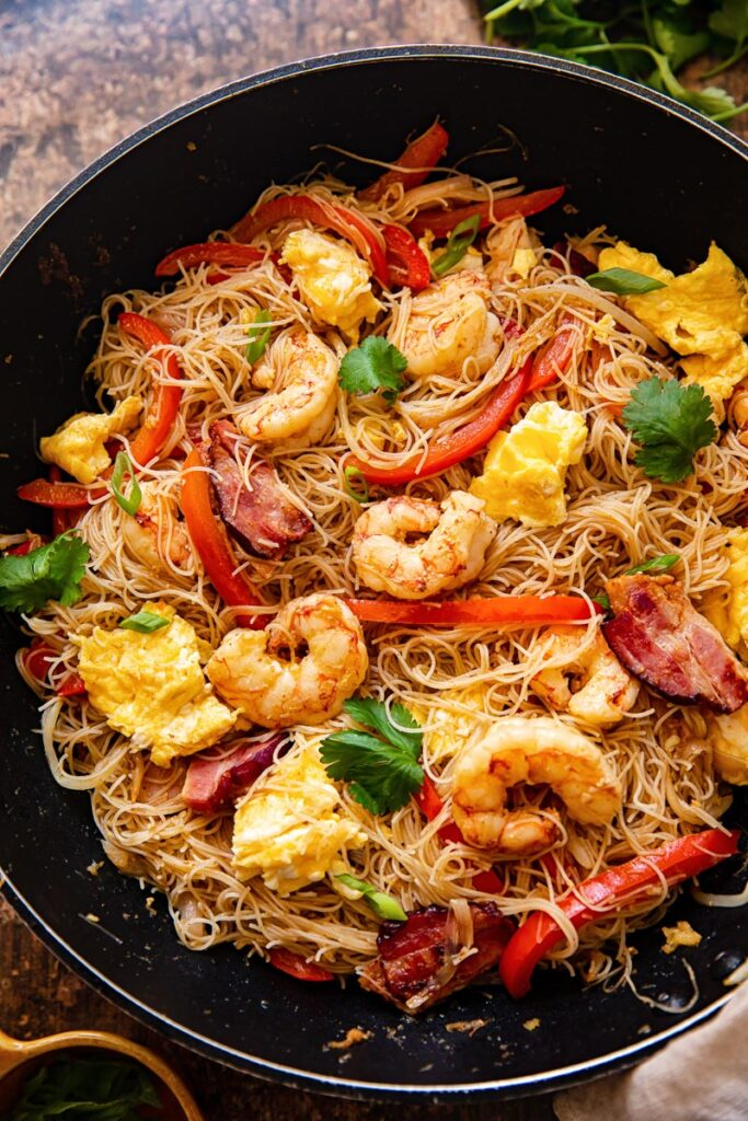 top down view of Singapore Noodles in a wok