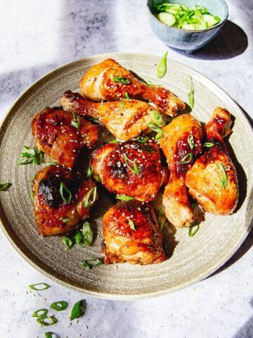Asian chicken on grey platter on grey background