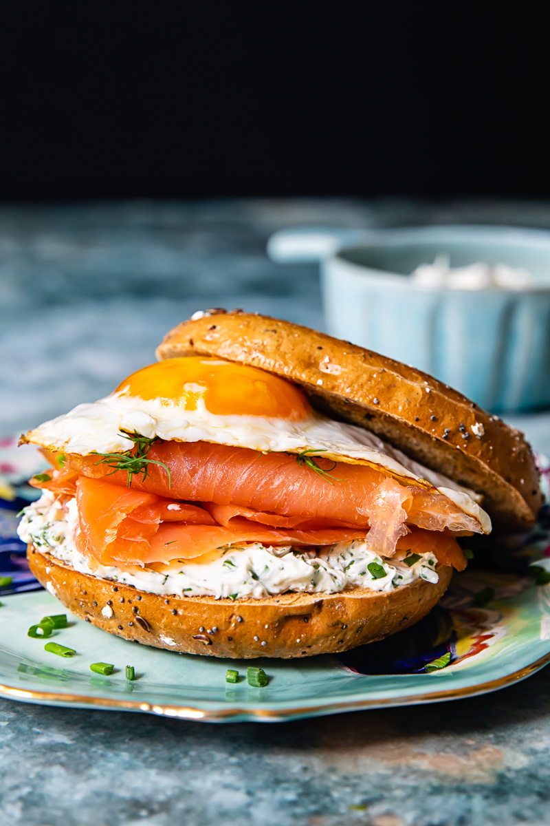 breakfast sandwich with egg and smoked salmon in a bagel