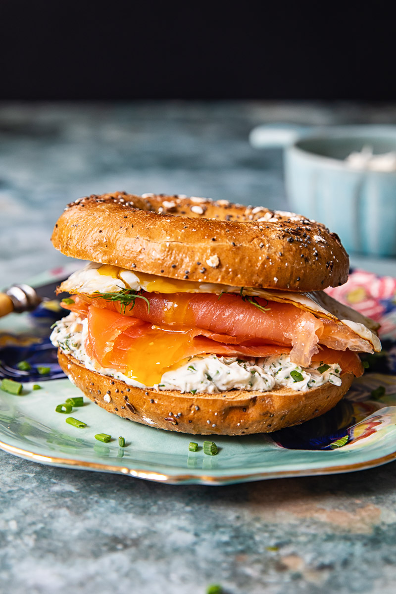 breakfast bagel with smoked salmon, cream cheese and egg