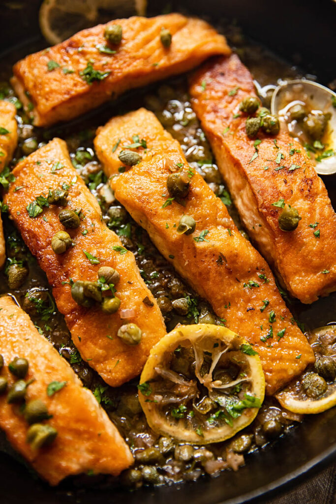 pan seared salmon topped with capers and lemon slices