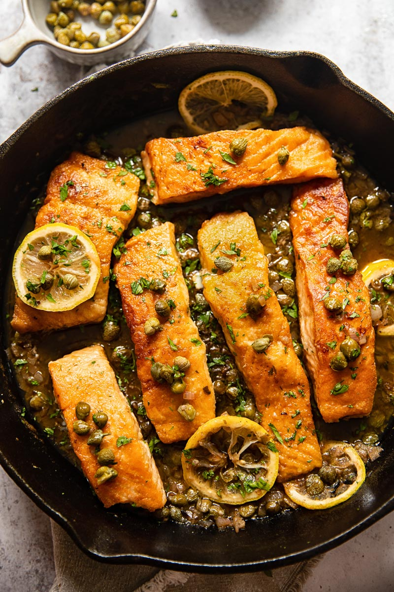 top down view of pan seared salmon with piccata sauce