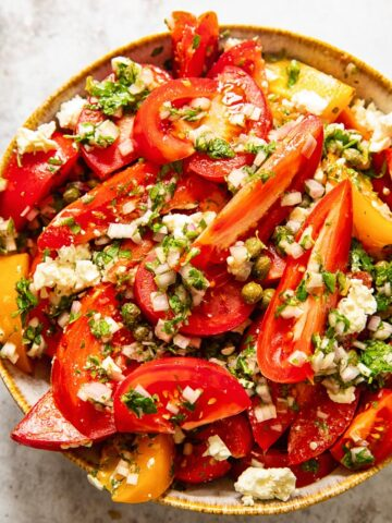 top down view of tomato salad in a bowl