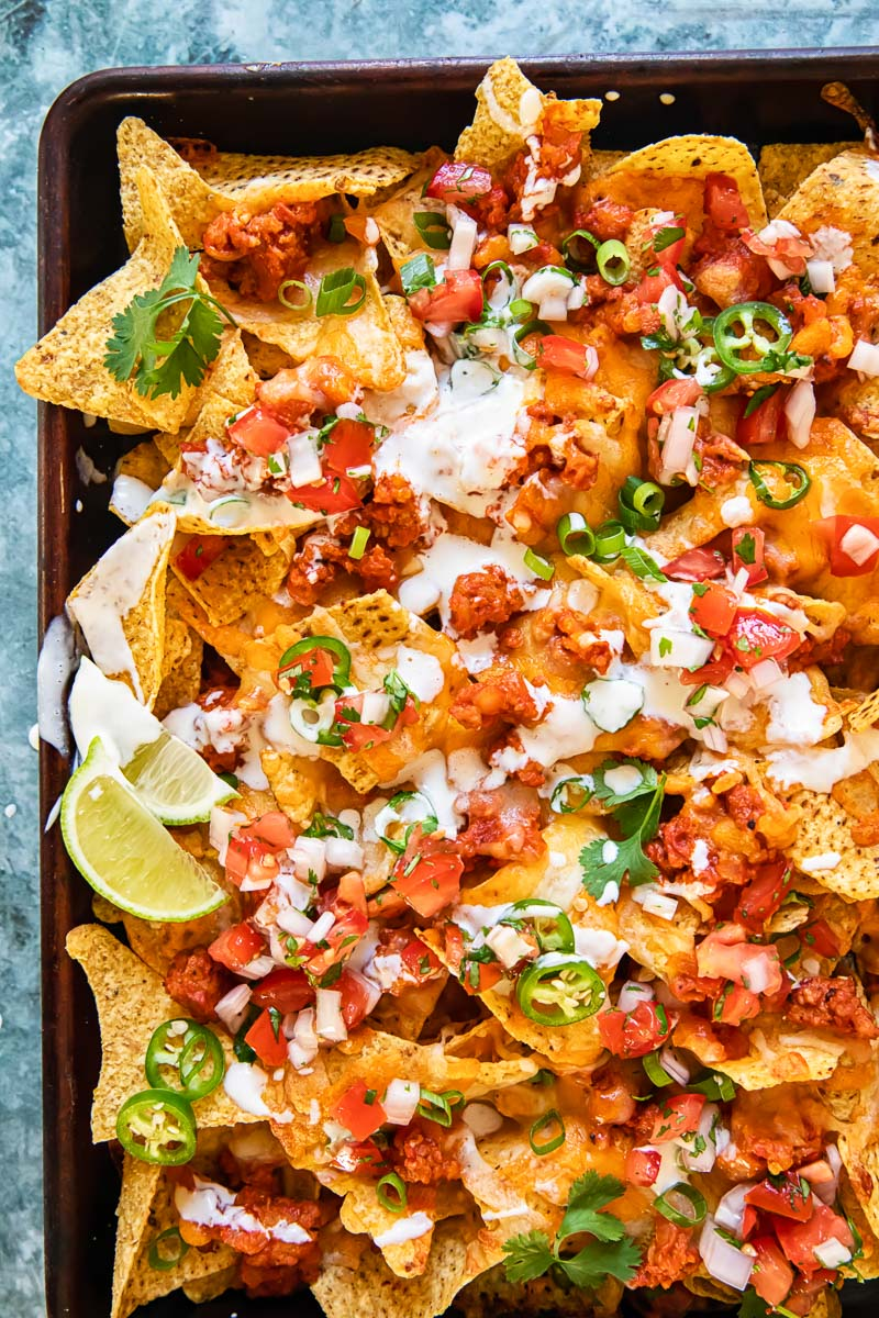 topped down view of nachos supreme in a sheet pan