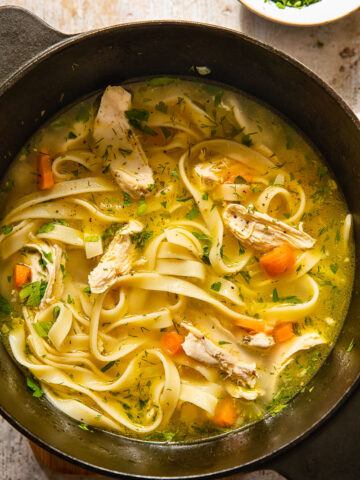 top down view of chicken noodle soup in a pot