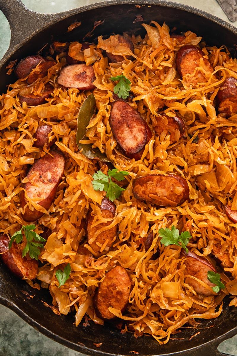 sauerkraut with kielbasa in a frying pan